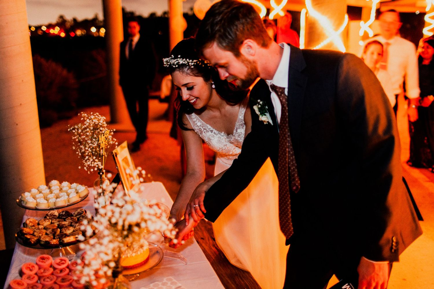 bride and groom cut cake after dancing