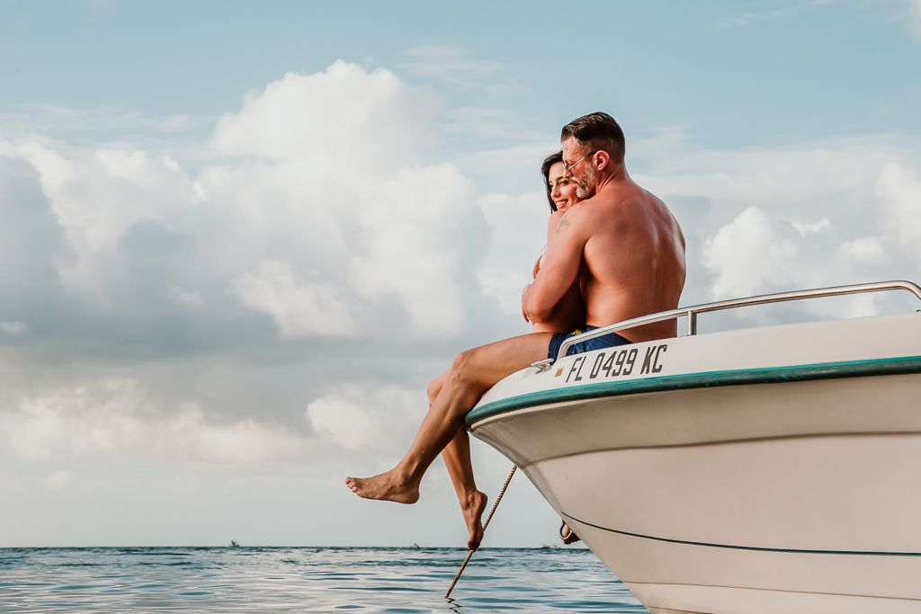 couple kissing on a yacht