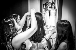 Ladies arranging the Bride in front of the mirror