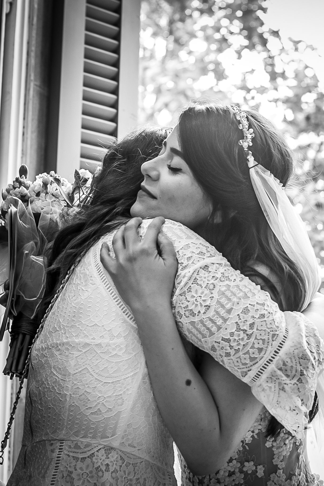 Bride hugging her friend after getting married