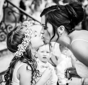 Bride kissing her flower girl at Highcliffe Castle