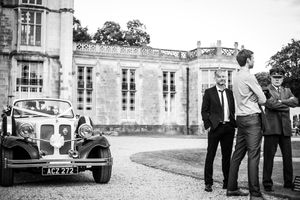 Classic wedding car in front of Highcliffe Castle in Dorset
