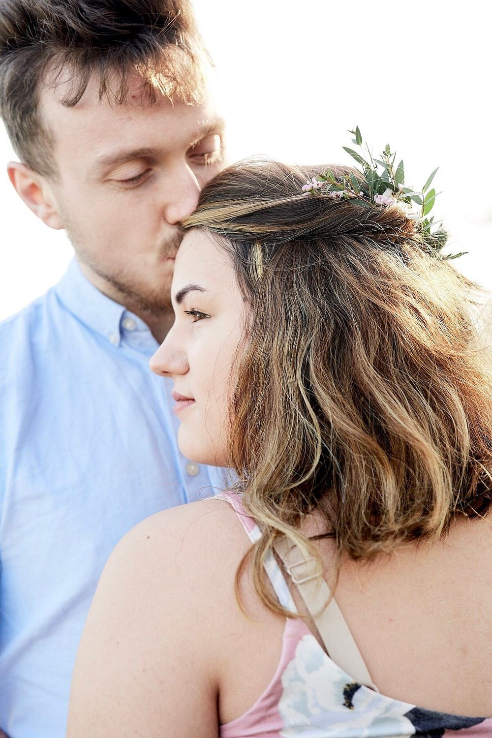 newly engaged couple kissing his fiance on the temple by Norwich Wedding Photographer Faye Amare Photography