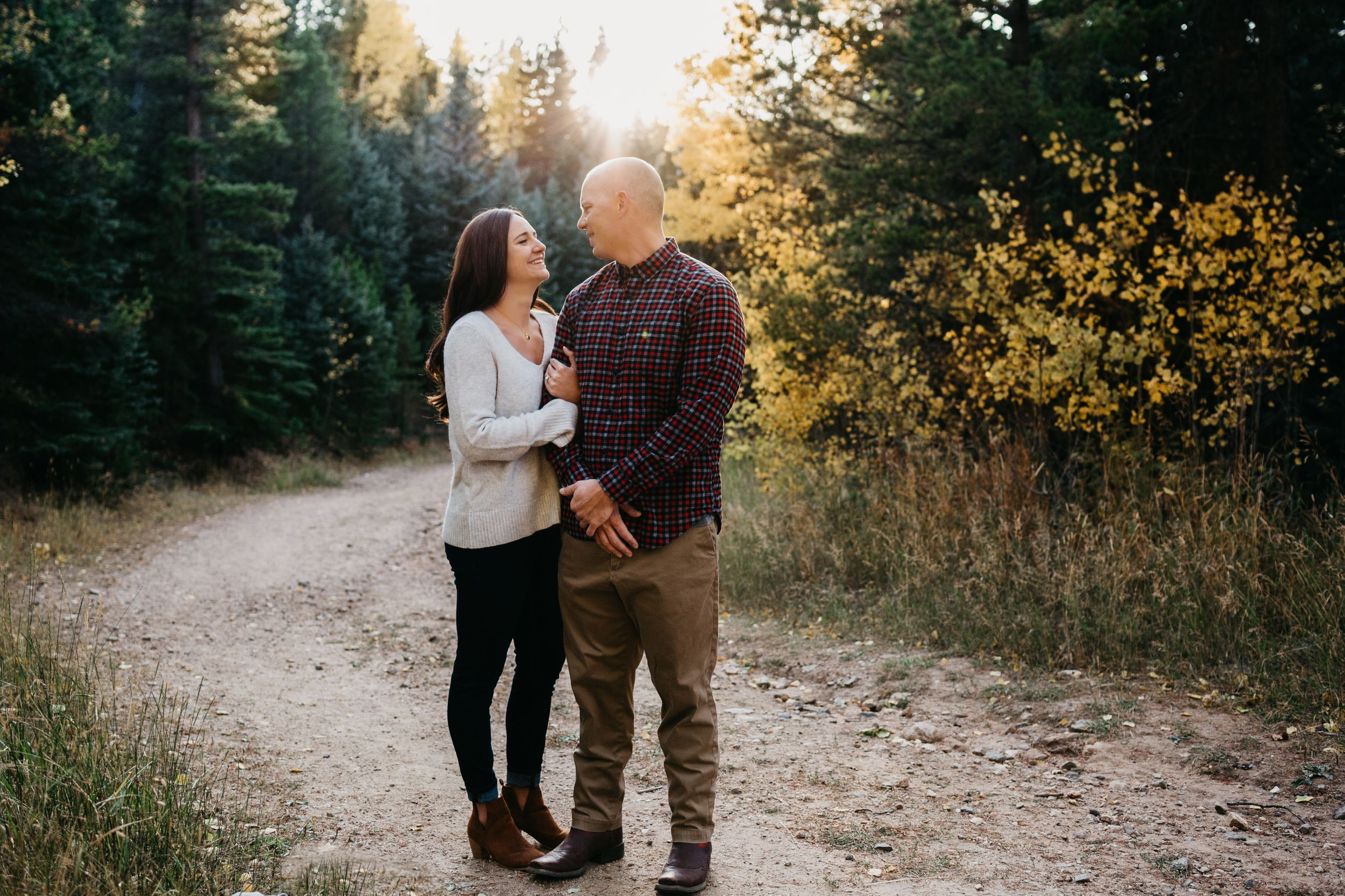 Sun flare and beautiful light sunset engagement session Evergreen, Colorado