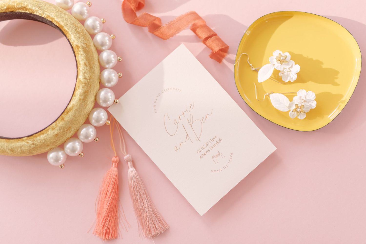 wedding details flatlay with fashionable statement velvet hairband with pearls and floral earrings by alabaster dream