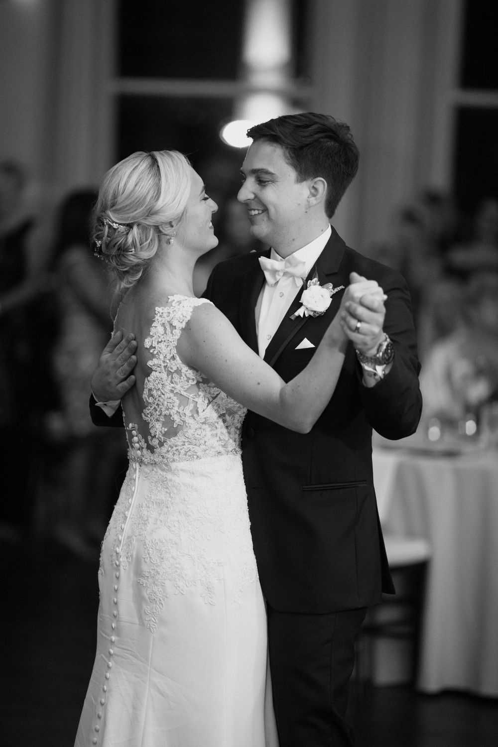 Bride and groom sharing a first dance at a traditional ballroom wedding.