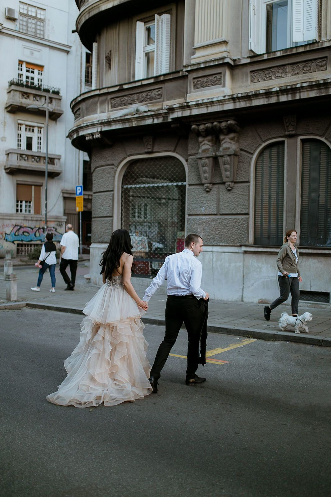 Bride and groom in walking in a romantic city