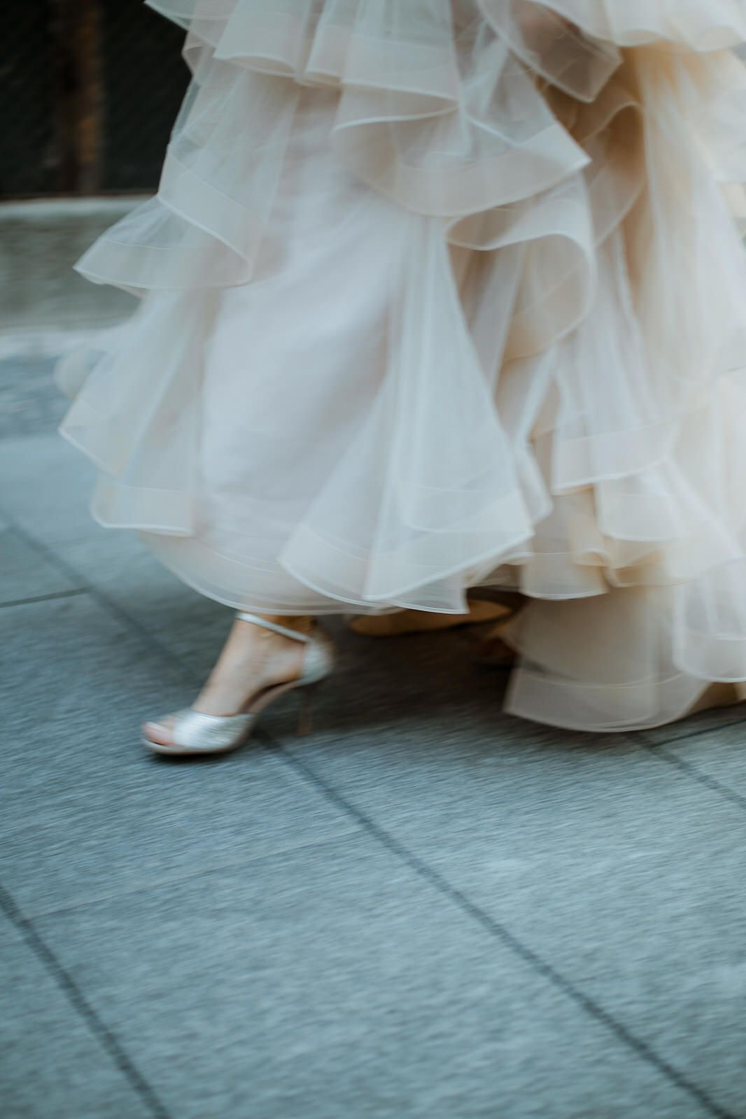 Bride walking down the street in custom made shoes