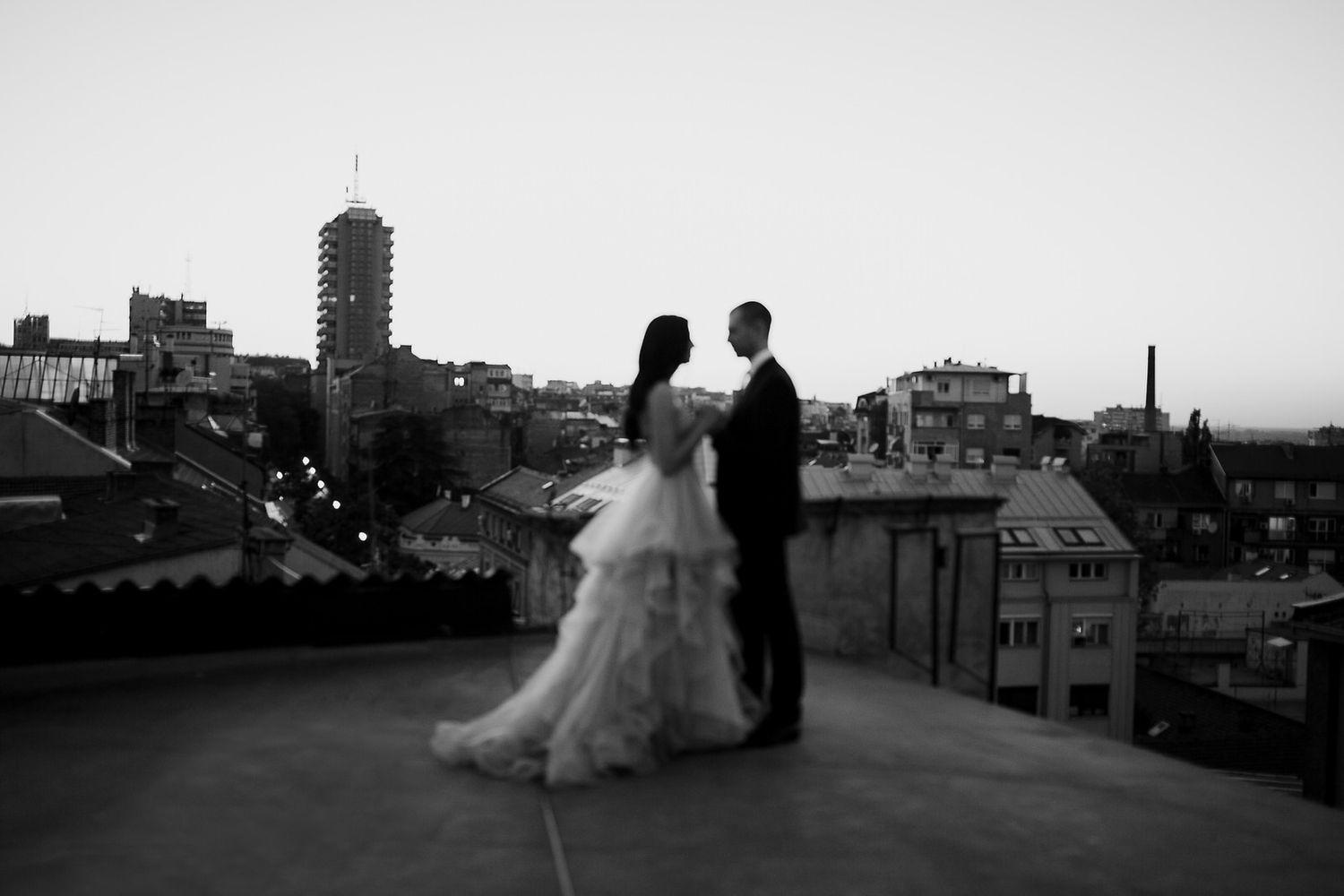 Bride and groom on a rooftop