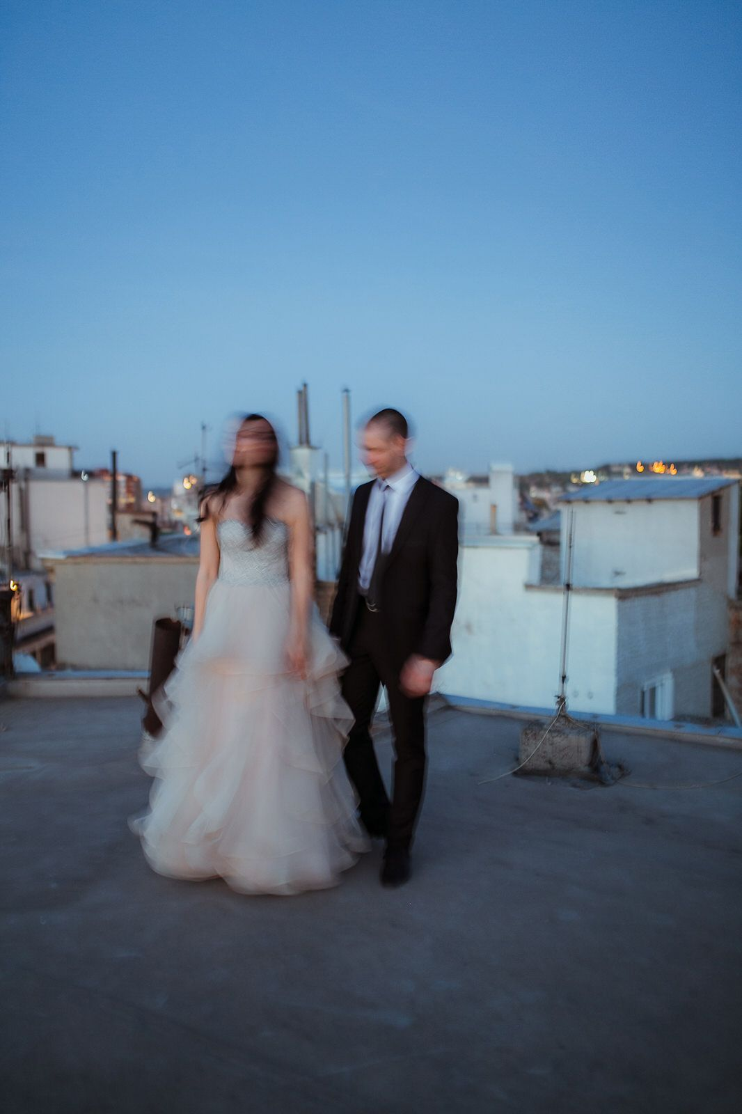 Bride and groom artistic and blurry walk on the rooftop