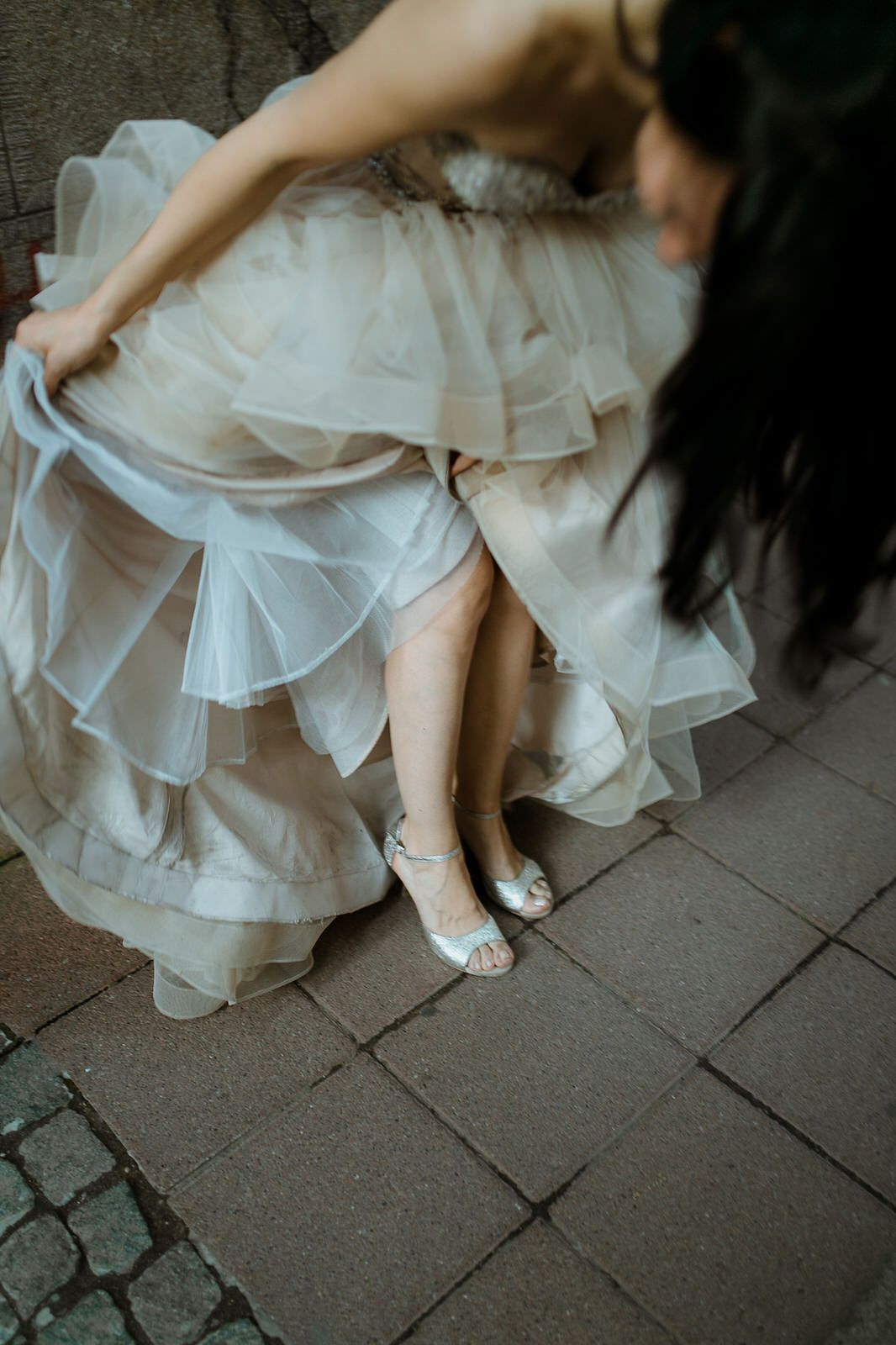 Bride in custom made wedding shoes