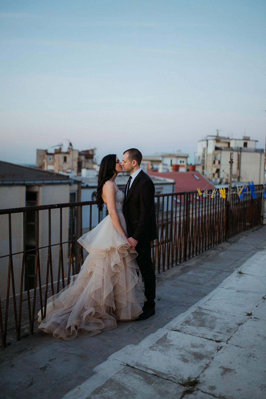 Bride and groom on a rooftop in Paris