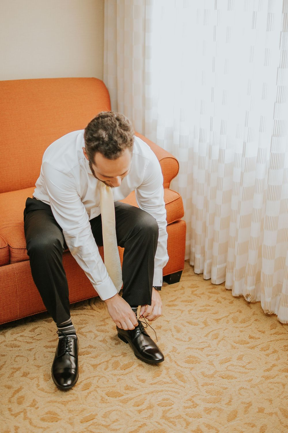 rebecca skidgel photography crow canyon country club danville wedding photographer groom getting ready putting on shoes