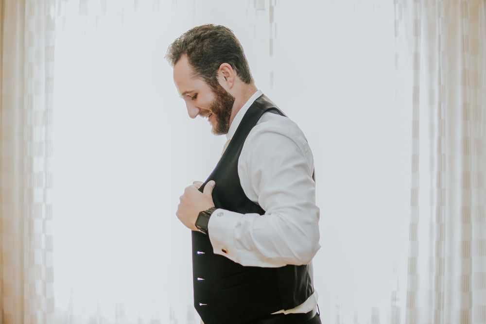 rebecca skidgel photography crow canyon country club danville wedding photographer groom getting ready putting on vest