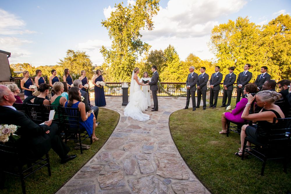 Bride Ashley and groom Jared exchange vows during their wedding ceremony at Stone River in West Columbia, SC