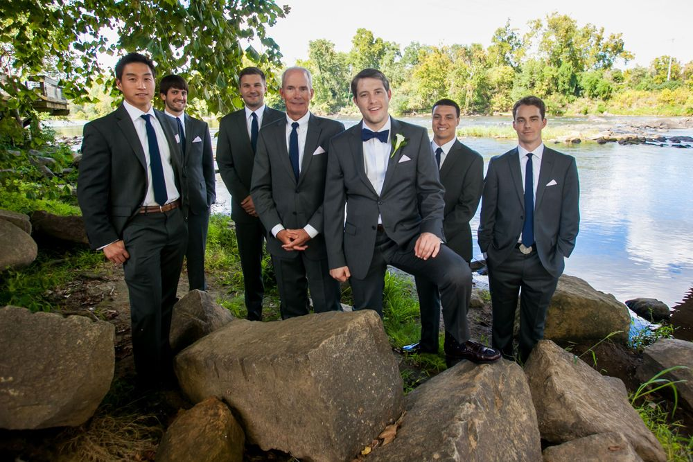 Jared and his groomsmen pose under the Gervais Street Bridge before his wedding at Stone River in West Columbia, SC