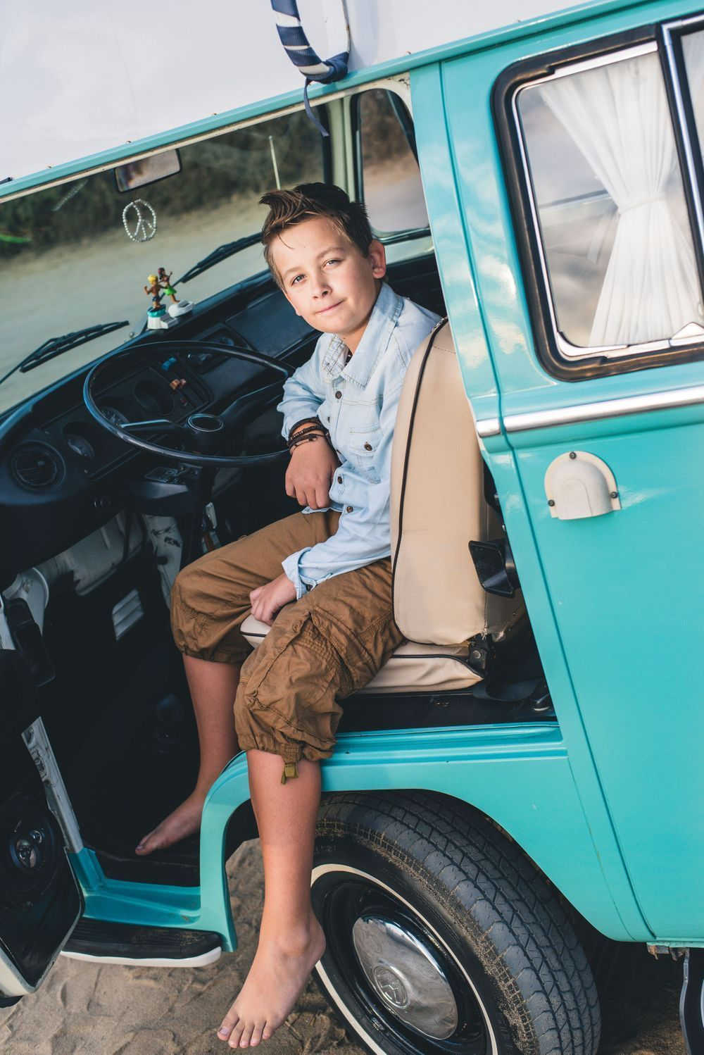 Photo of a boy sitting in a VW Bus in San Clemente, CA