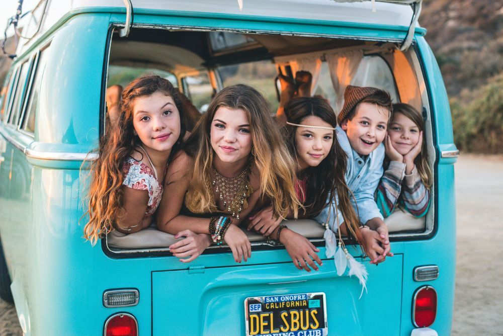 Photo of a family in a VW Bus on a beach in San Clemente, CA
