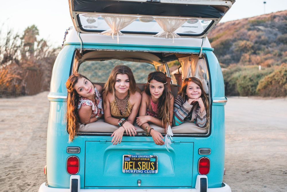 Photo of brothers and sisters in a VW Bus in San Clemente, CA