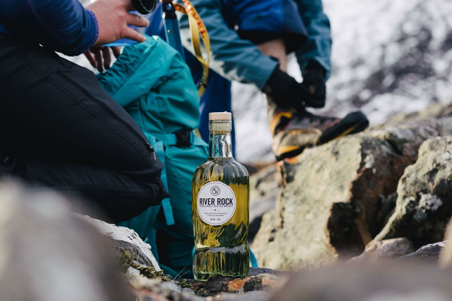 River Rock Whisky on a Scottish mountaineering hiking adventure in the Highlands product shoot