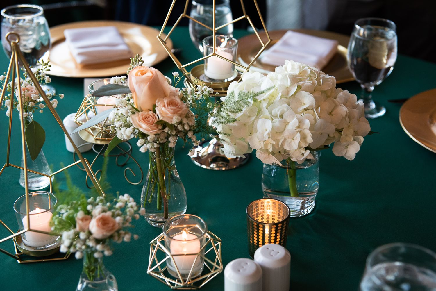 gold and green table settings at wedding in colorado springs