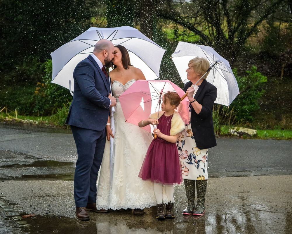 Wedding party portrait in rain at Lindeth Howe Hotel