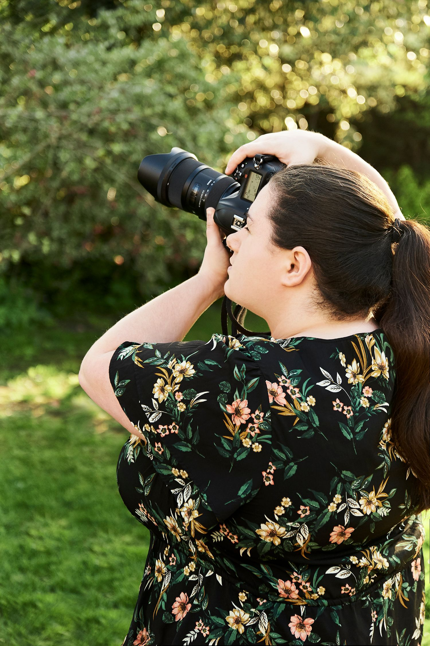 photo of norfolk wedding photographer Faye Amare Photography holding a camera