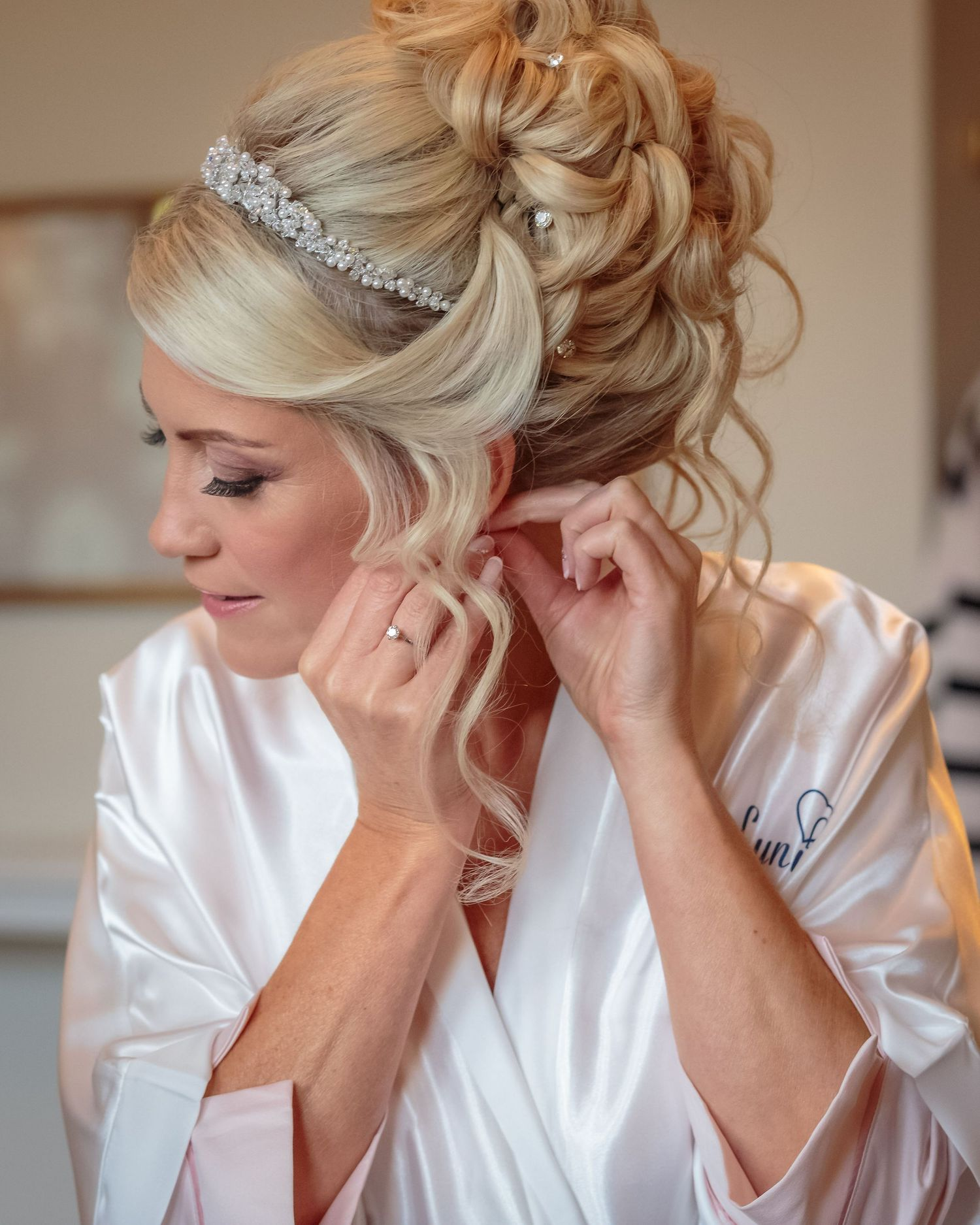 bride putting in her ear rings during the bridal prep