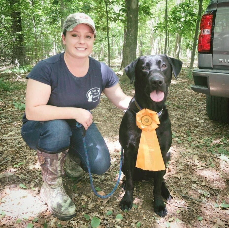 Kate Lussier CT Photographer at a hunt test with her Lab