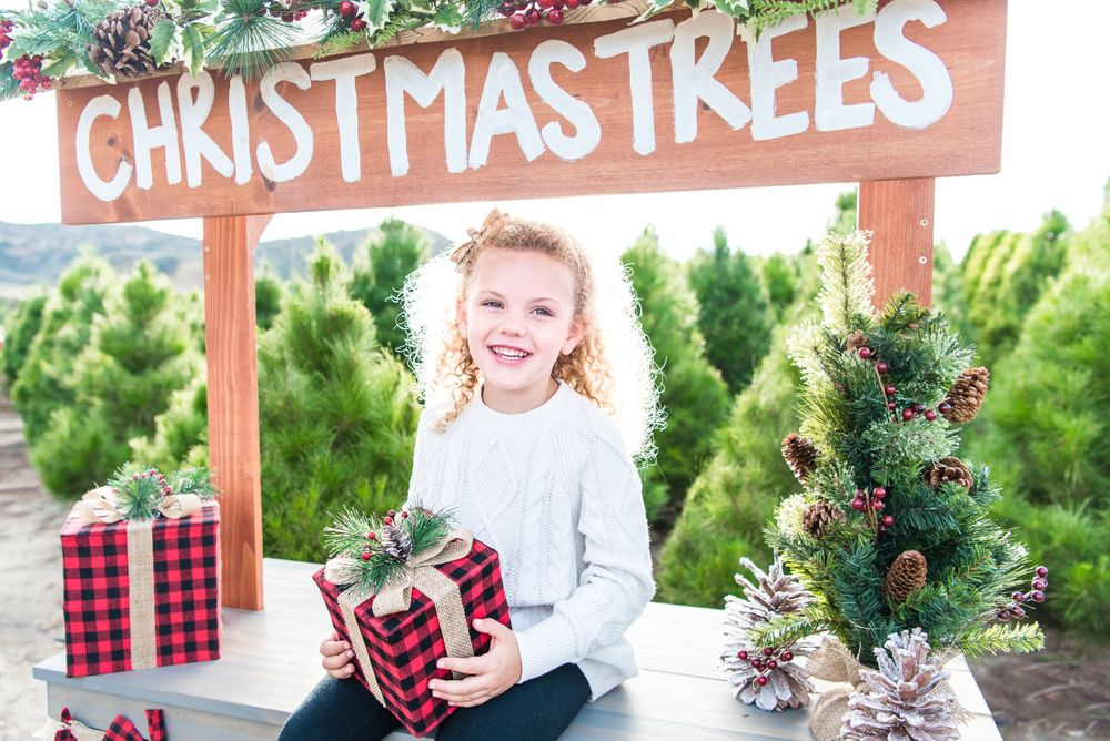 Photo of a girl at a christmas tree farm in orange county, ca