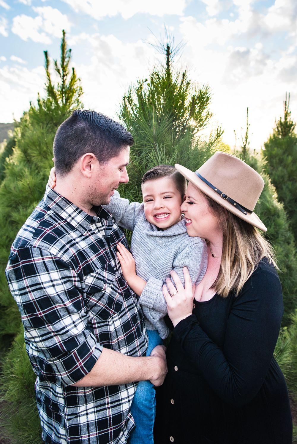 Photo of a family at a Christmas Tree Farm in Orange County, CA
