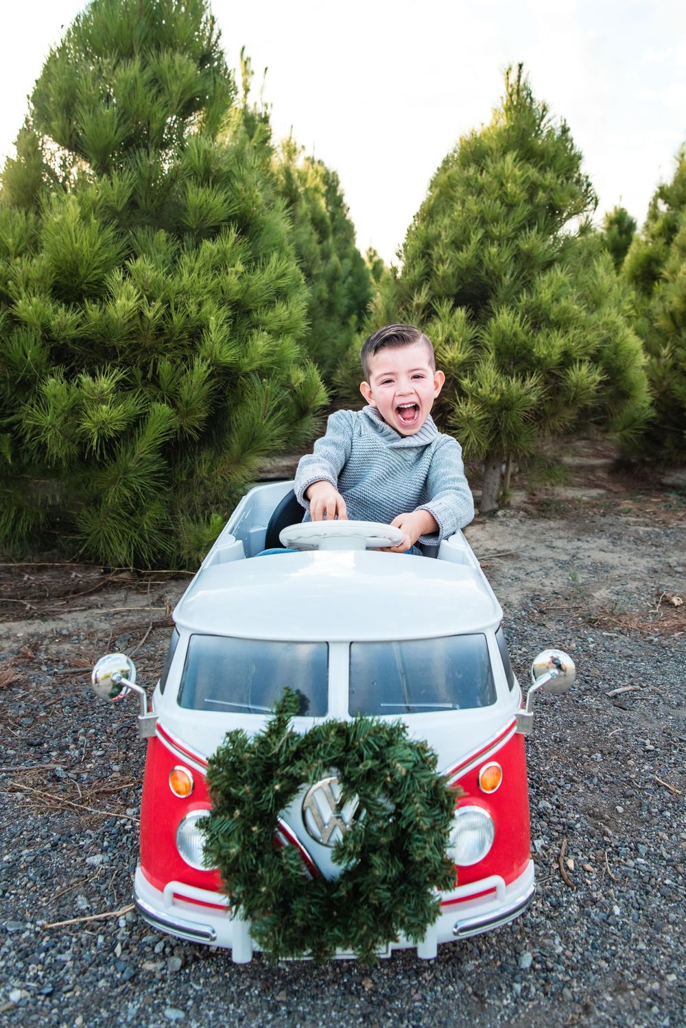 Photo of a boy in a small car at a Christmas Tree Farm in Orange County, CA