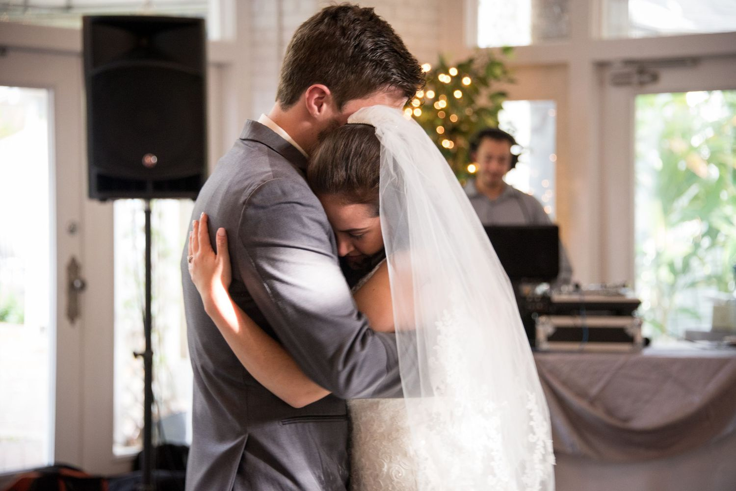 Couple embraces in a hug during their first dance at the Sweet Water Branch Inn, Wedding Photographer Chris Watkins.