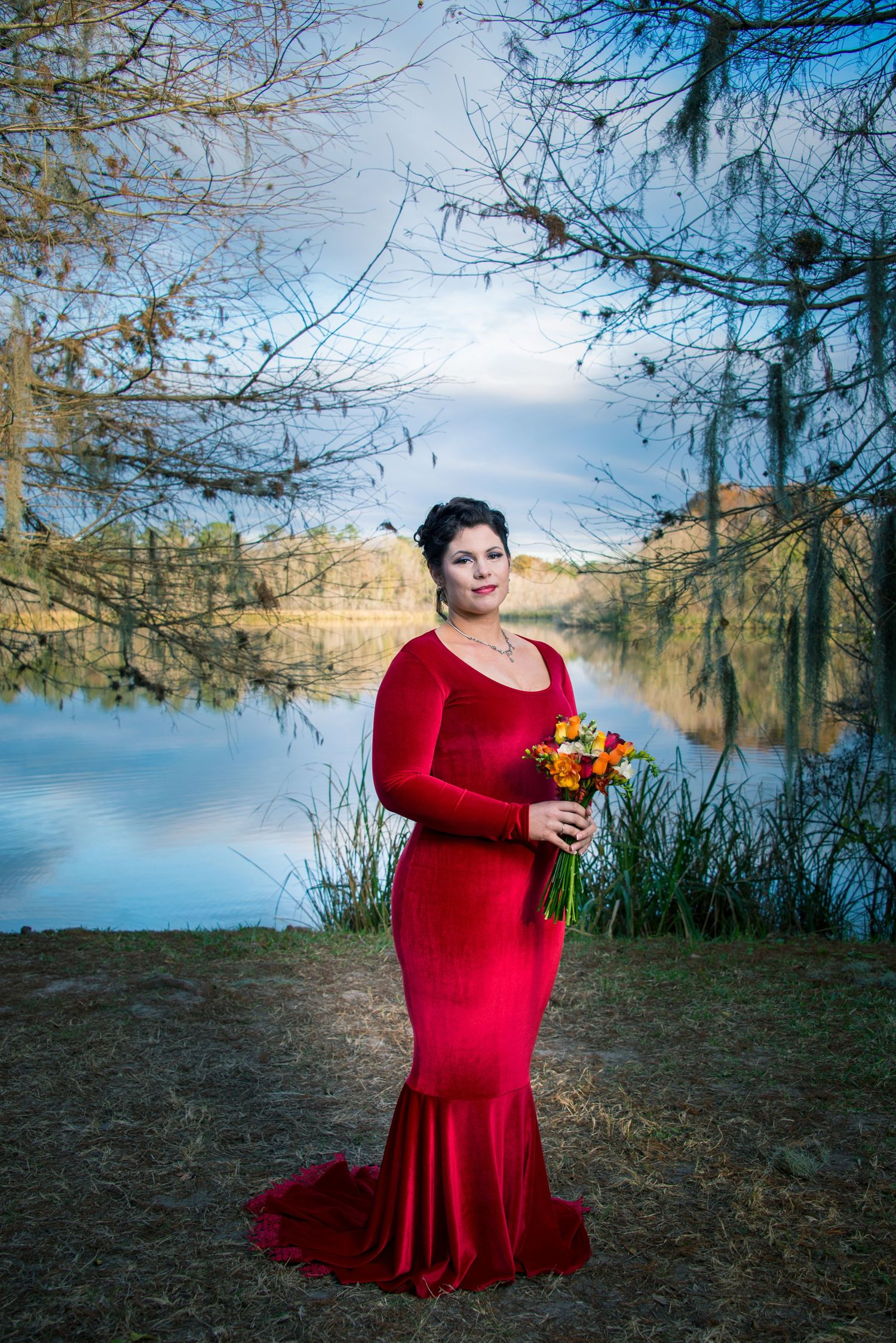 A bride poses for a formal bridal portrait by the Baughman Center at the University of Florida.