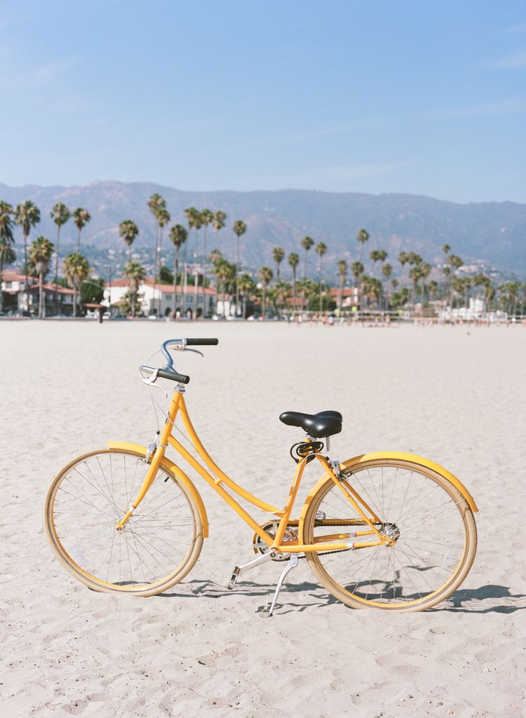 Santa Barbara California wedding Photographers Aaron Snow Photography yellow bike on beach