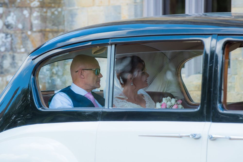 view of bride and father in the car window, Robert Nelson Wedding Photography