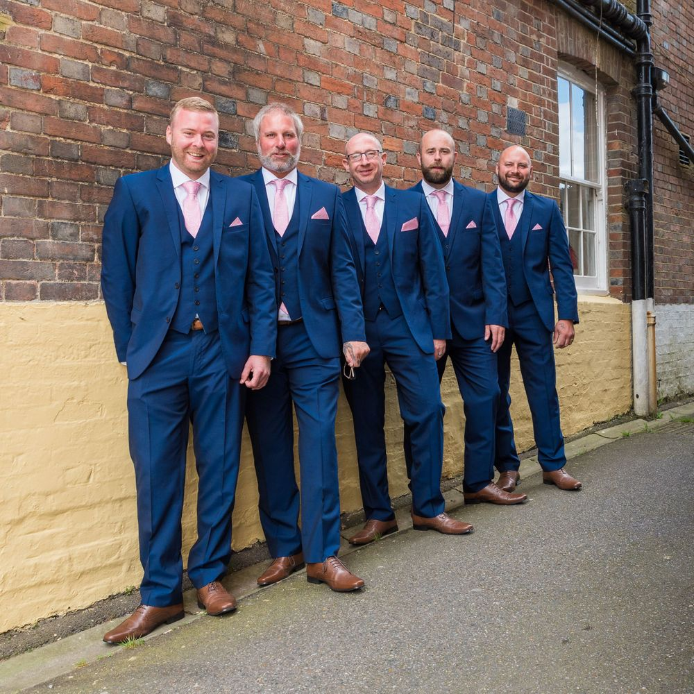 the groom and his men lined up against a wall, Robert Nelson Wedding Photography