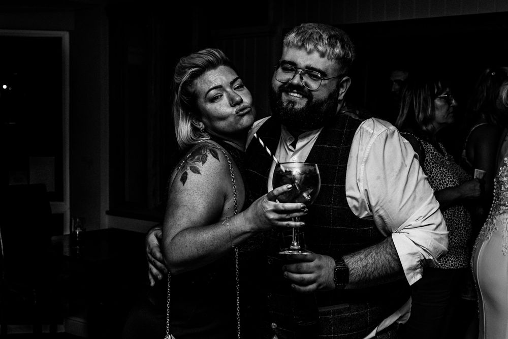 Black and white photo of guests having fun at wedding in Wales