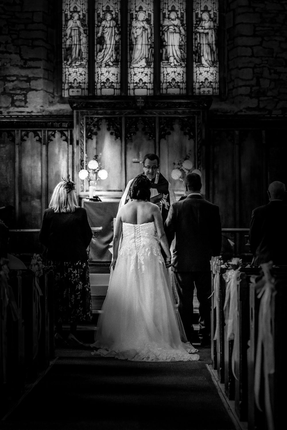 Black and white photo of church wedding service in Manchester
