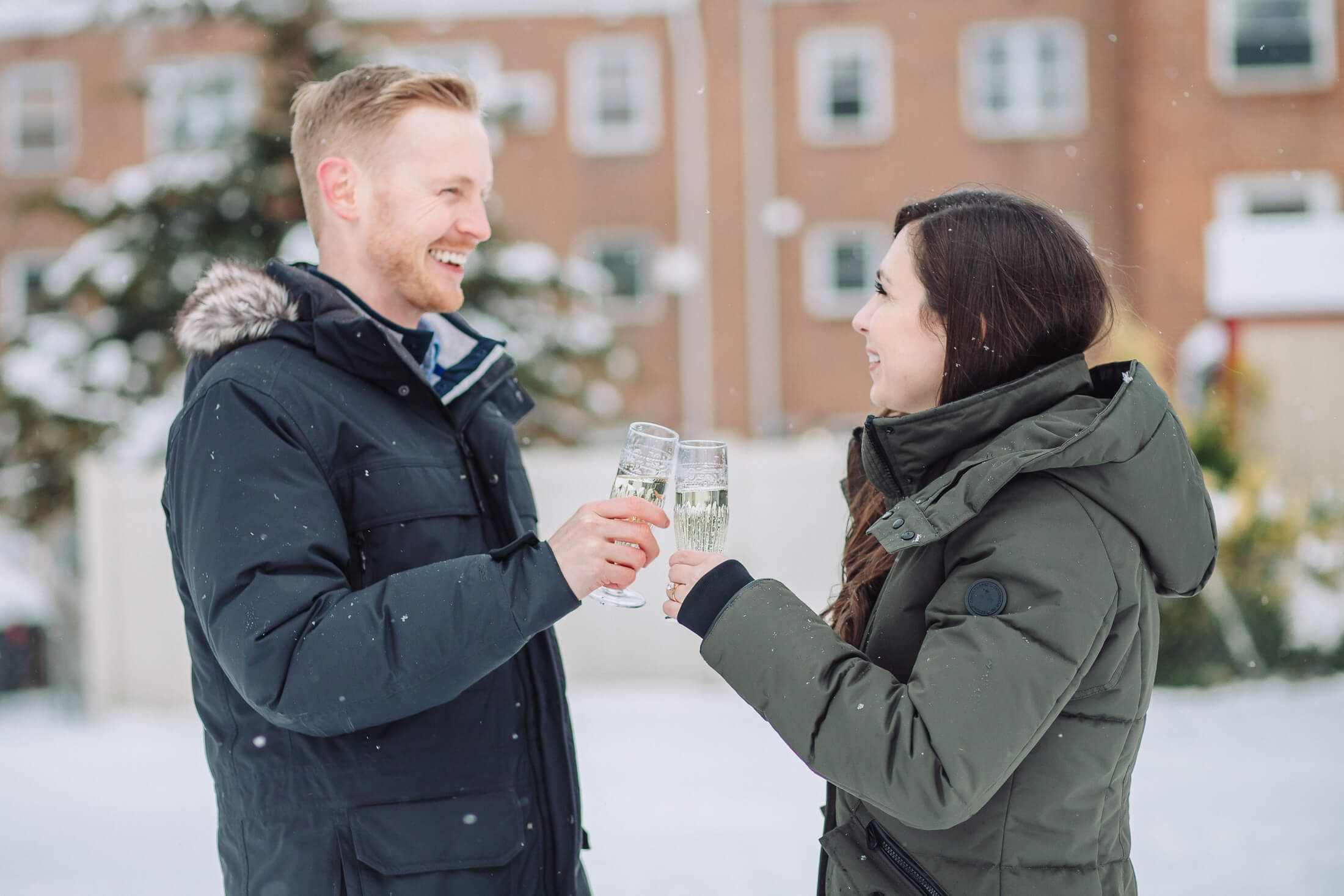 Winter outdoor champagne toast with engaged couple with Cherry Hill engagement photographer.