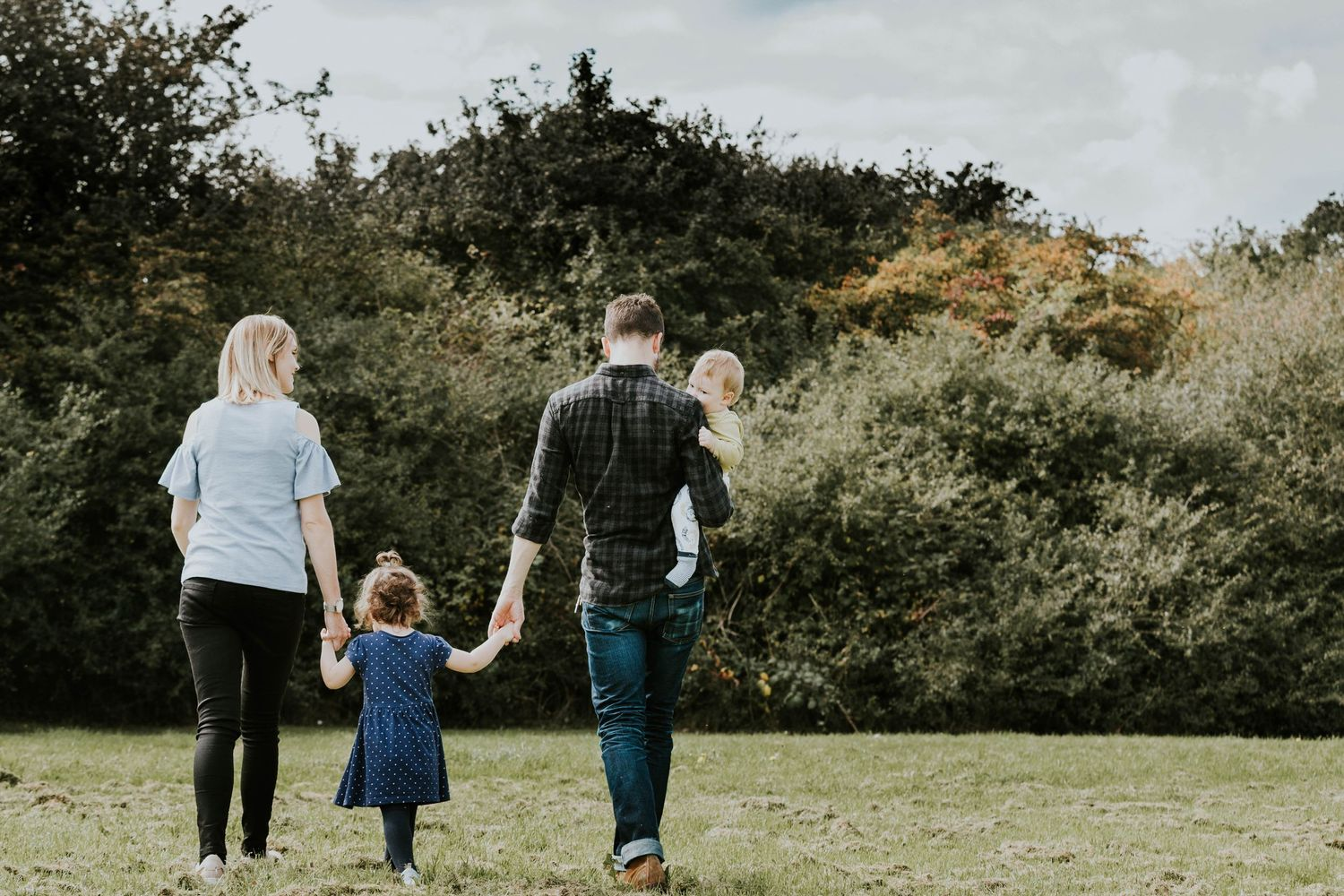 Hornchurch family of four walking in field