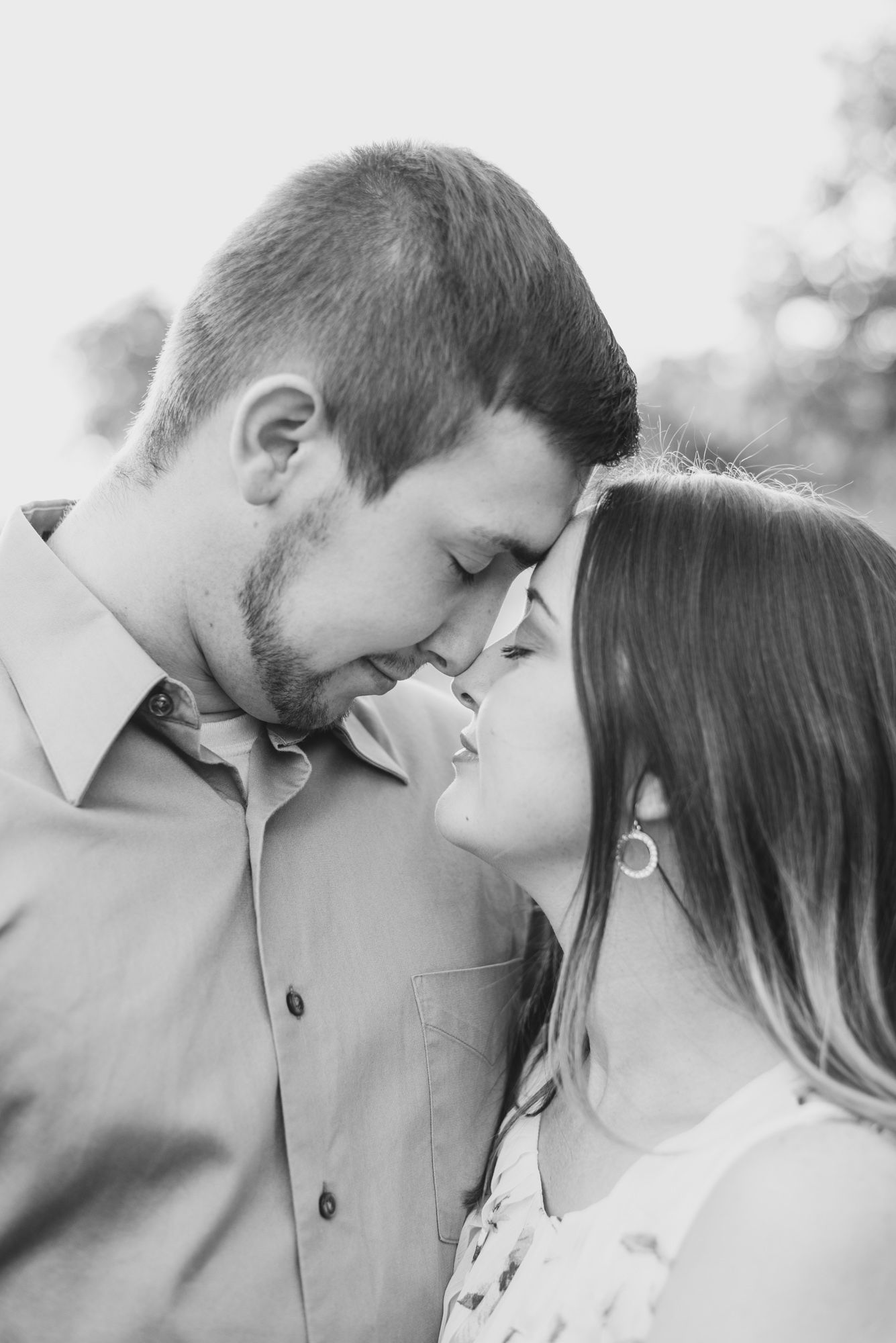 Couple touching forehead in black and white at Moraine State Park in Pennsylvania