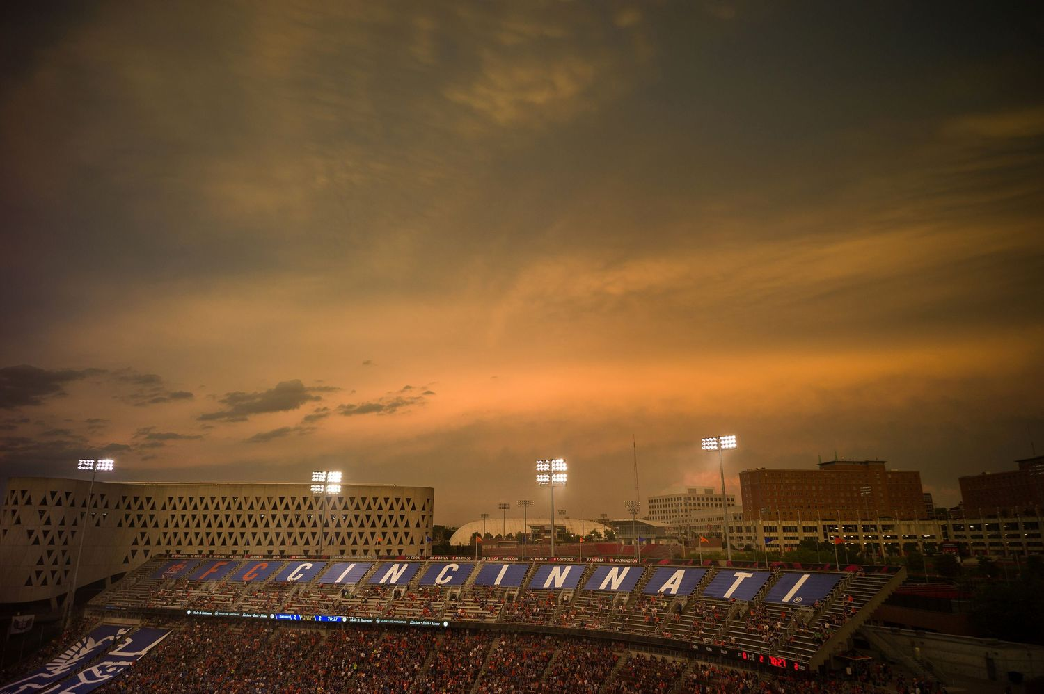 sun shone on the clouds as the lights came on at Nippert Stadium, in the University of Cincinnati, at a FC Cincinnat