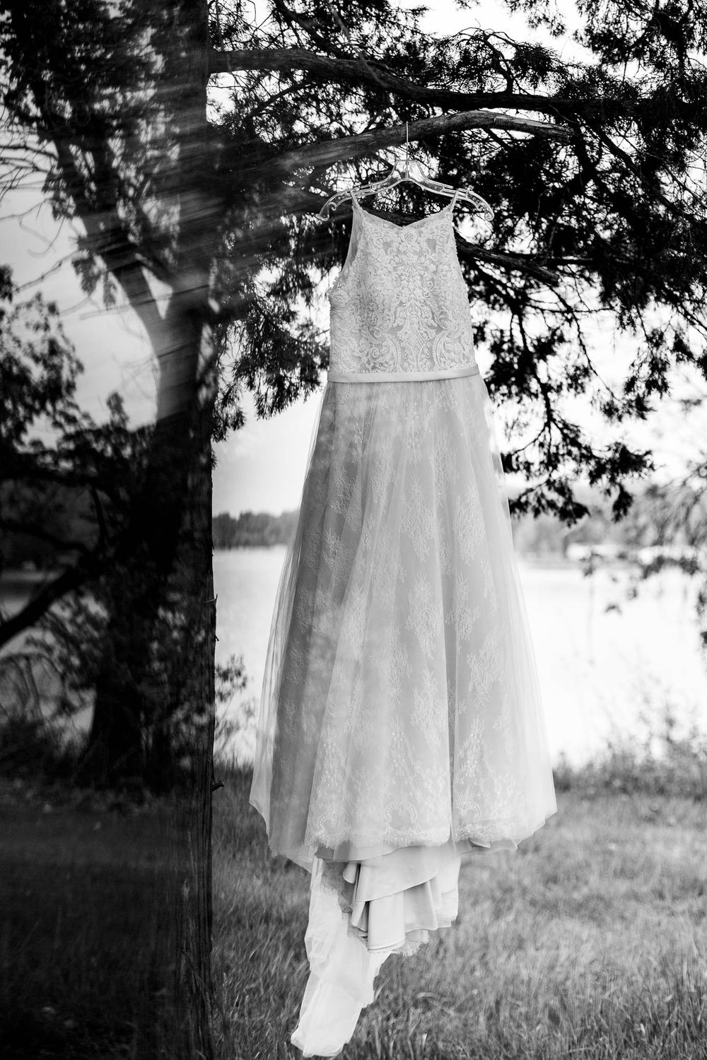 A wedding dress hangs from a tree at Camp Nebowa in Iowa