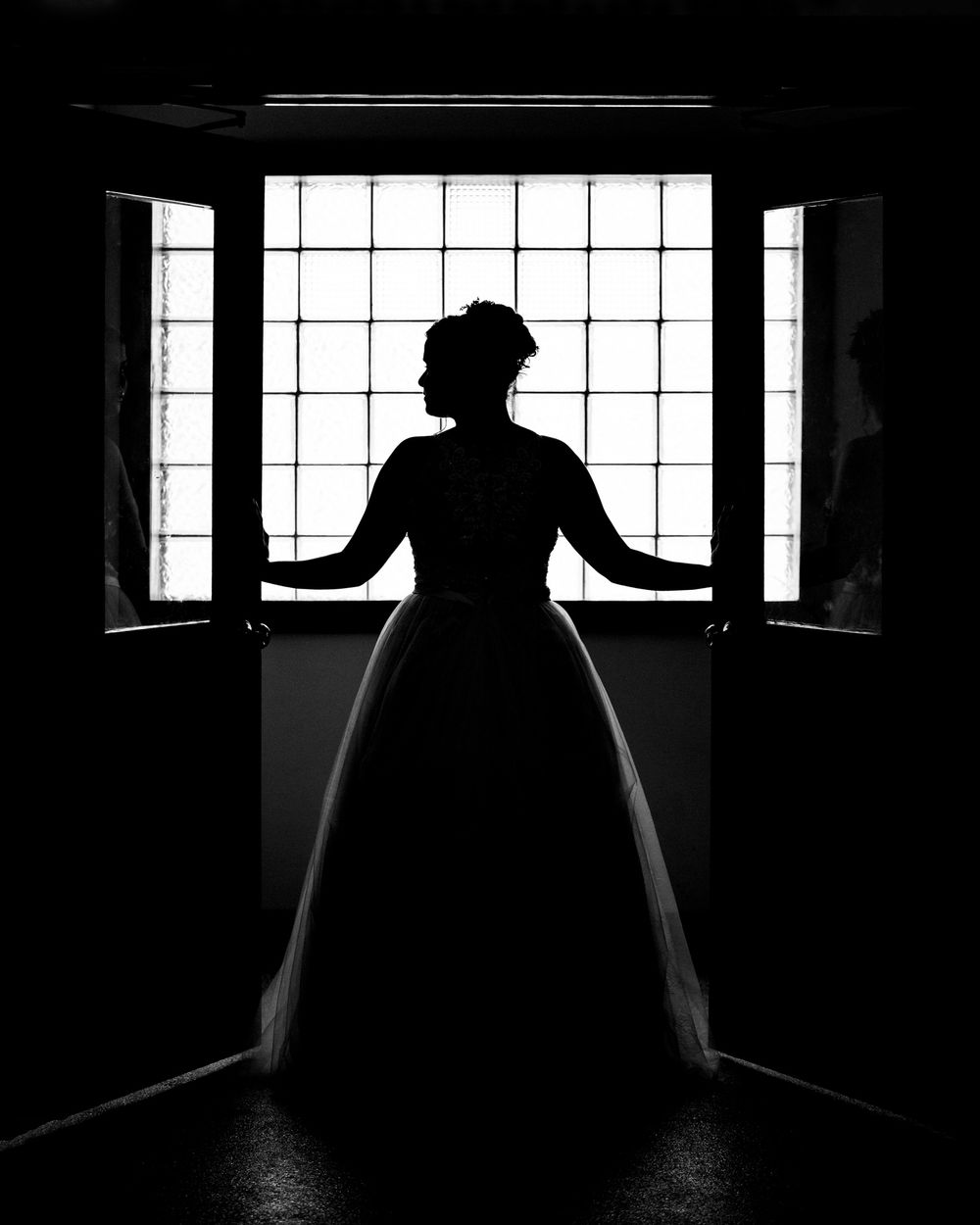 Black and white silhouette of a bride.