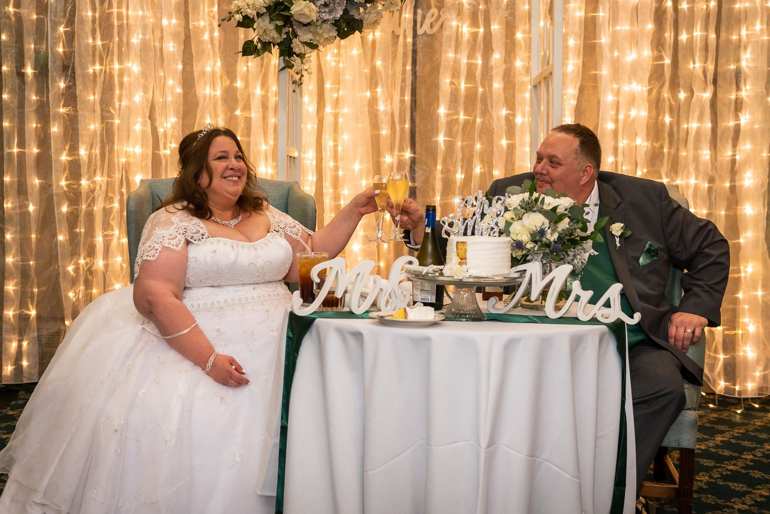 Wisconsin wedding couple raise their glasses in a toast on their wedding day