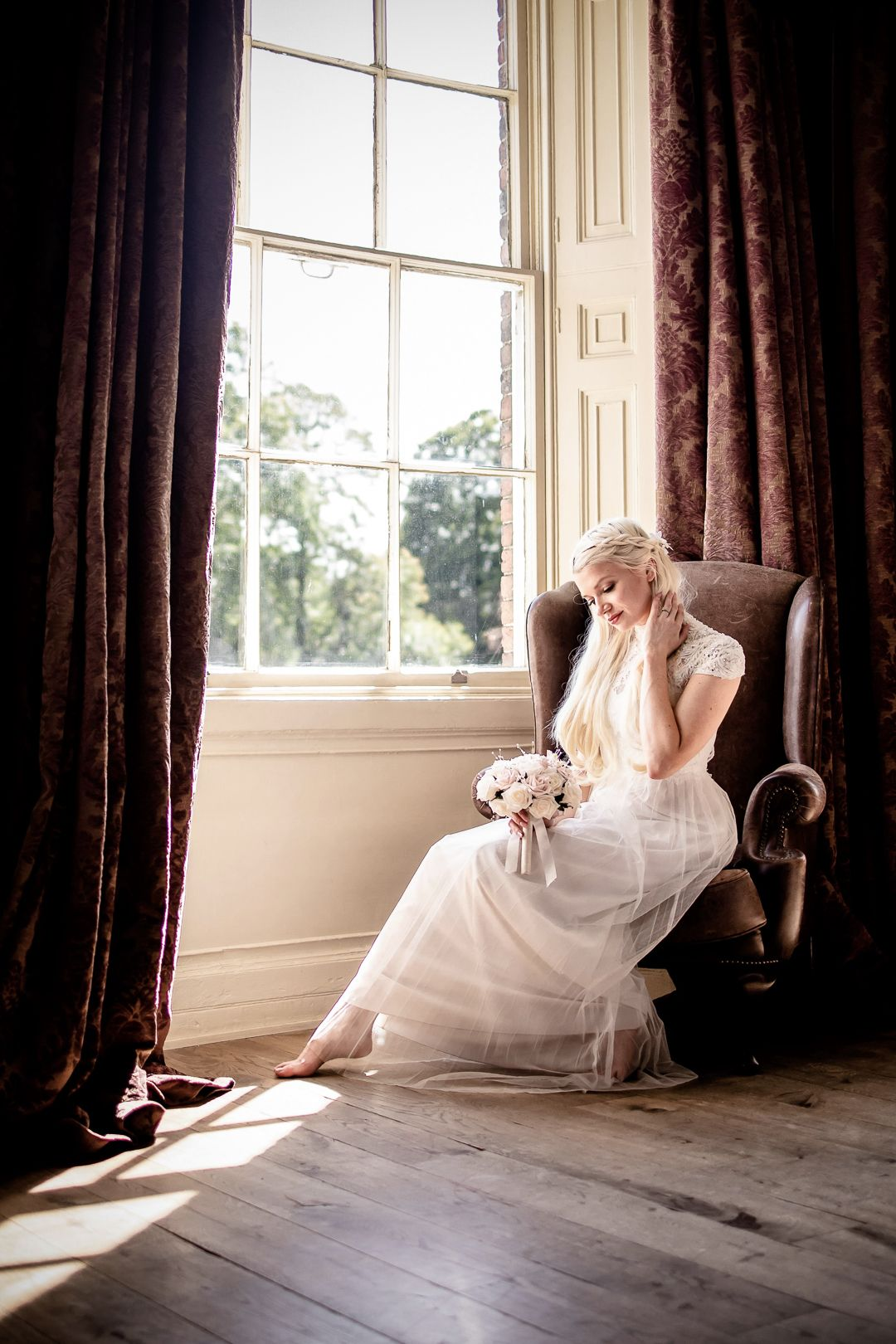 Wedding bride sitting in a manor house chair