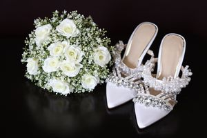 Bride's shoes and bouquet