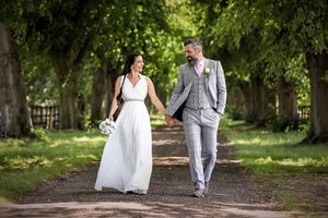 Bride and groom walking around a country estate