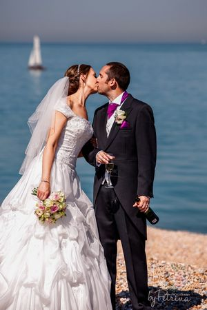 Bride and groom kissing on a beach